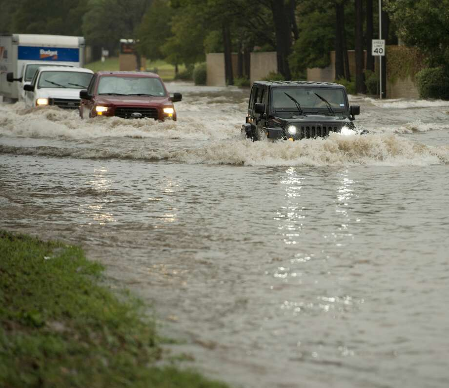 Rainfall continues Friday in Midland, flooding the area of Wadley and I Street, as well as others streets around town. Tim Fischer/Reporter-Telegram Photo: Tim Fischer/Midland Reporter-Telegram
