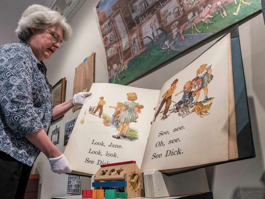 Curator Stacy Pomeroy Draper works on a display of some of the artifacts that have been collected for the exhibit that is being mounted Friday Sept. 7, 2018 at the Rensselaer County Historical Society in Troy, N.Y.  (Skip Dickstein/Times Union) Photo: SKIP DICKSTEIN, Albany Times Union / 20044729A