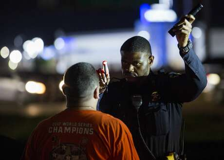 Harris County Precinct 8 deputy constable Jonathan Toliver administers a field sobriety test to a man suspected of driving while intoxicated on the Gulf Freeway Service Road.