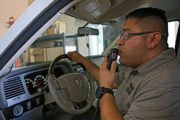 Smart Start assistant manager Omar Hernandez blows into the ignition interlock system to make sure the device works properly.