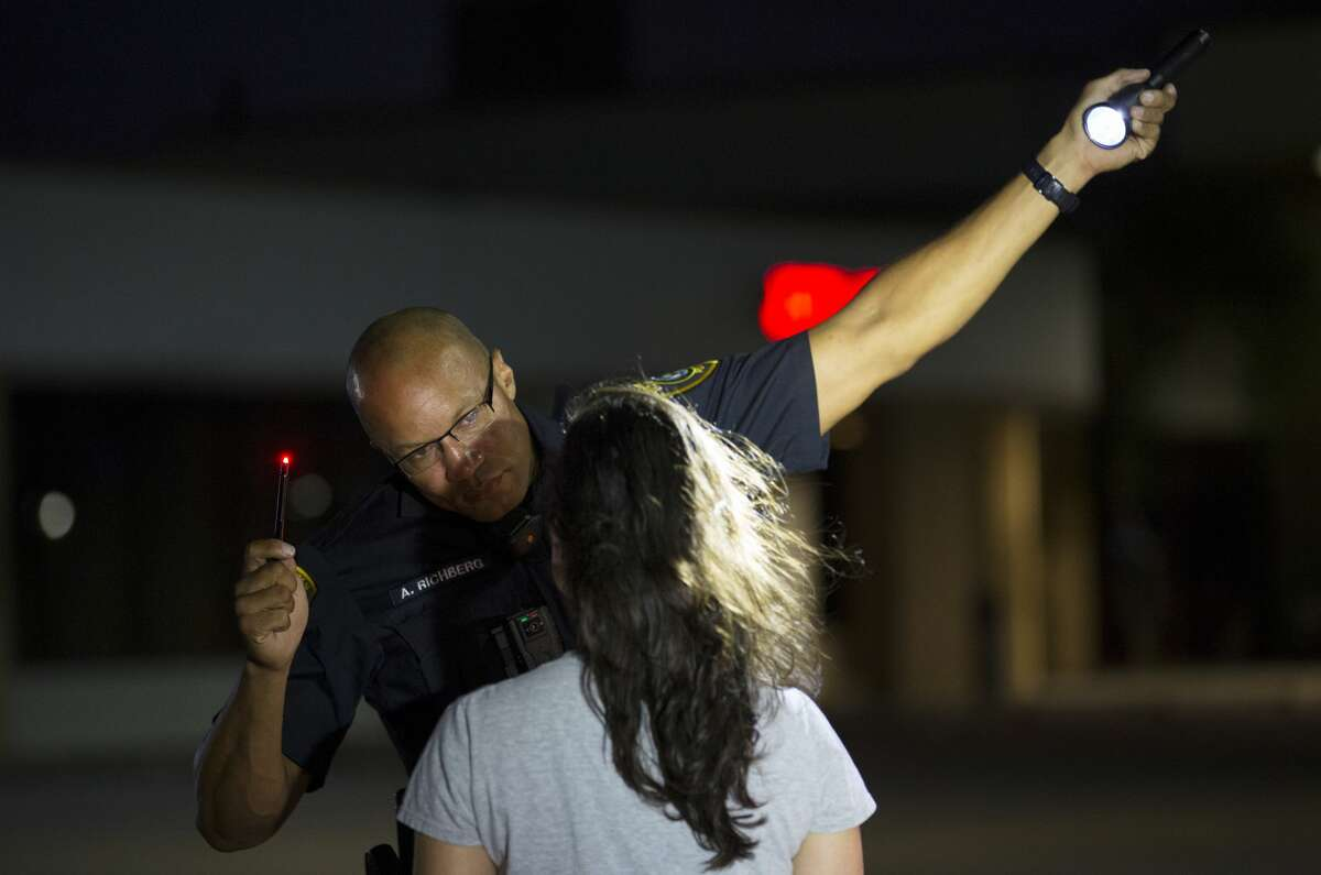 Houston Police officer Aaron Richberg conducts a drunk driving test during a traffic stop.
