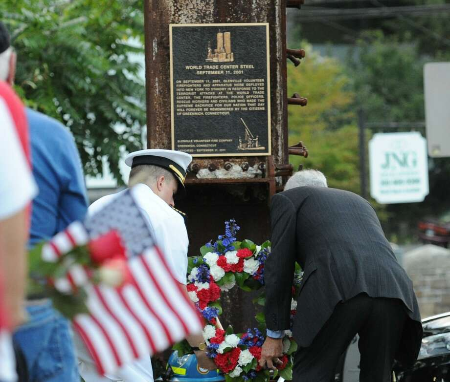 The 17th anniversary of the Sept. 11 attacks will be marked with a ceremony from 7:30 to 8 p.m.Sept. 11 at the Glenville Firehouse. A wreath will be placed at a memorial made from a piece of steel from the World Trade Center that was salvaged from the wreckage. A ceremony will be held as well at the town's Sept. 11 memorial in Cos Cob Park from 6 to 7 p.m. Sept. 11. Photo: File / Bob Luckey / Bob Luckey / Greenwich Time