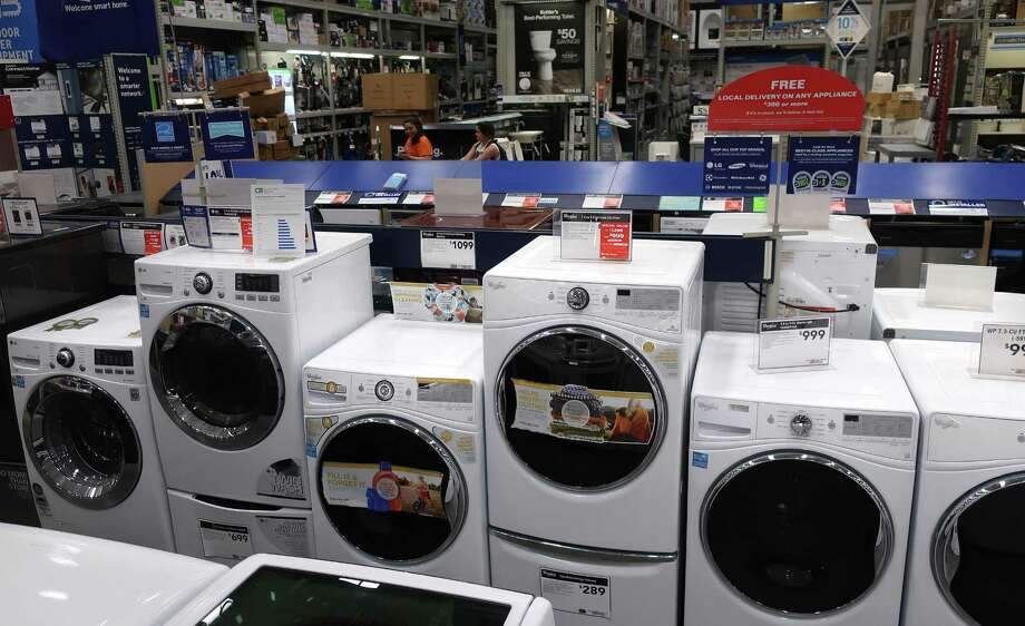 This May 21, 2018, file photo shows a row of washing machines for sale at Lowe's Home Improvement store in East Rutherford, N.J. Online retailers are trying hard to get more people to buy stoves, washing machines and other large appliances without seeing them in person. Since its an expensive purchase that is expected to last several years, see if you can find the appliance you like in a store so you can touch and feel the materials and see if the color will work for your home. Photo: Ted Shaffrey /Associated Press / Copyright 2018 The Associated Press. All rights reserved.