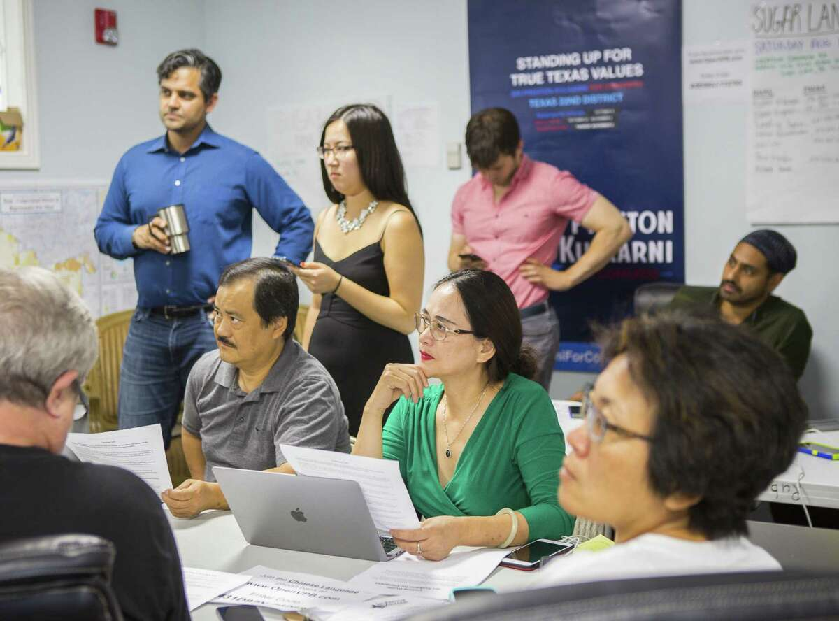 Volunteers prepare to phone bank in the campaign office of Democrat Sri Preston Kulkarni on Thursday, Aug. 30, 2018 in Sugar Land. Kulkarni's staff has been running phone banking operations with various volunteers who can speak a diverse group of languages from Mandarin Chinese to Tamil to Spanish. The 22nd Congressional District Kulkarni is running in is considered the most diverse in the state and includes Sugar Land and much of the rest of Fort Bend County.
