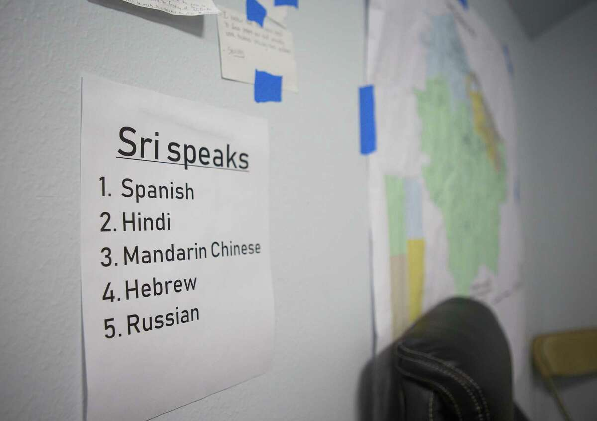 A note tapped to the wall reminds volunteers which languages the candidate they are volunteering for, Sri Preston Kulkarni, inside the campaign's office of on Thursday, Aug. 30, 2018 in Sugar Land. Kulkarni's staff has been running phone banking operations with various volunteers who can speak a diverse group of languages from Mandarin Chinese to Tamil to Spanish. The 22nd Congressional District Kulkarni is running in is considered the most diverse in the state and includes Sugar Land and much of the rest of Fort Bend County.