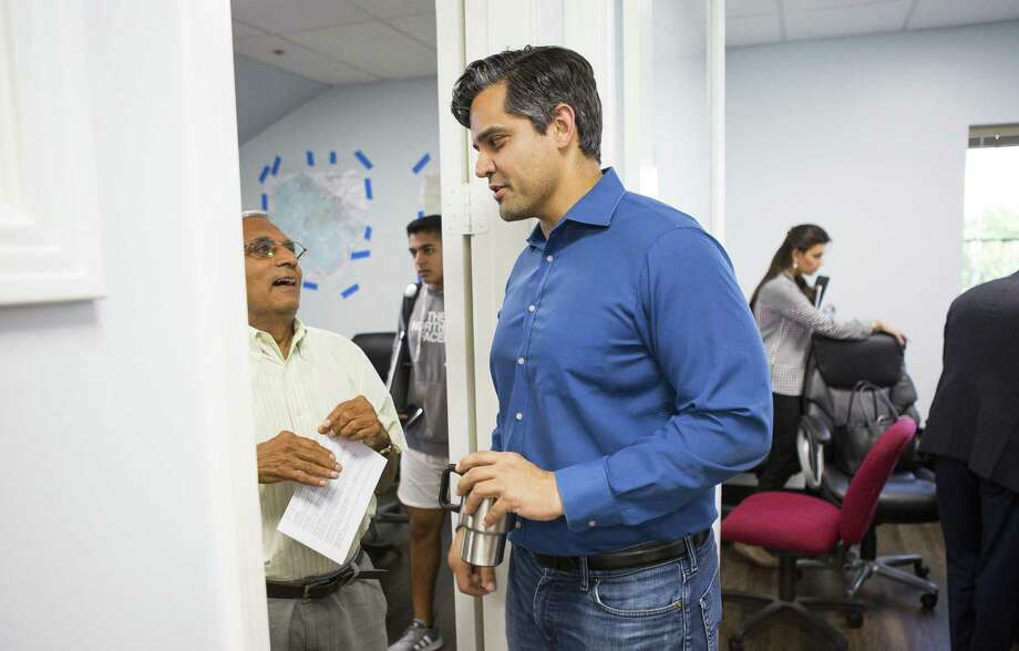 Democrat Sri Preston Kulkarni (center) talks with a supporter in his campaign office on Thursday, Aug. 30, 2018 in Sugar Land. Kulkarni's staff has been running phone banking operations with various volunteers who can speak a diverse group of languages from Mandarin Chinese to Tamil to Spanish. The 22nd Congressional District Kulkarni is running in is considered the most diverse in the state and includes Sugar Land and much of the rest of Fort Bend County. Photo: Mark Mulligan, Houston Chronicle / Staff Photographer / © 2018 Mark Mulligan / Houston Chronicle