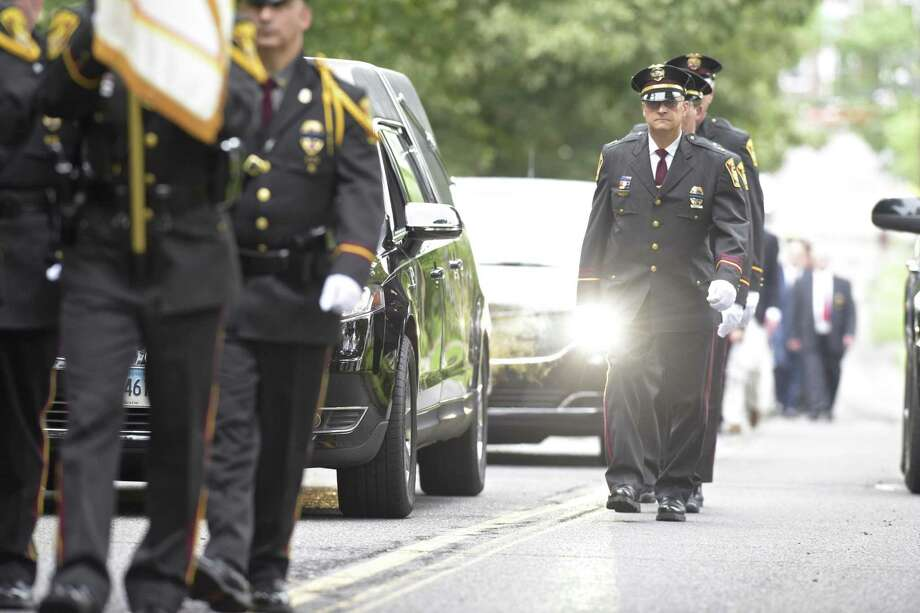 Funeral procession for former Ridgefield Police Chief John Roche, who died less than a week after retiring from the department. The service was held at St Mary's Church in Ridgefield, Conn, on Friday morning, September 7, 2018. Photo: H John Voorhees III / Hearst Connecticut Media / The News-Times