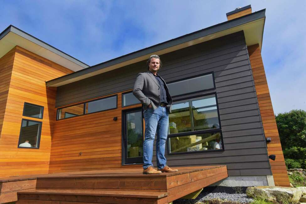 Architect/builder Ryan Berry stands outside a home he is building for a client on Maddy Grove Road, seen here on Thursday, Aug. 30, 2018, in Greenfield, N.Y. This home is one of the houses on the upcoming Showcase of Homes. (Paul Buckowski/Times Union)