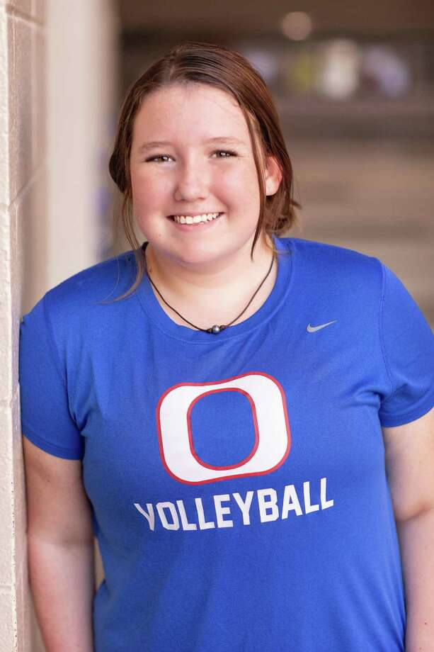 Oak Ridge volleyball manager Jessica Taylor has overcome cancer and has started her freshman year of high school as an important member of the Lady War Eagles family. Photo: Holley Davis Seniors Photography