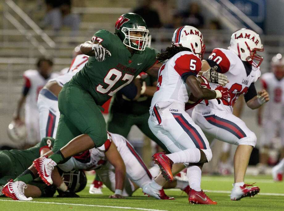 The Woodlands defensive lineman Armani Lowery (97) tackles Lamar running back Jaquon Marion (5) during the third quarter of a non-district high school football game at Woodforest Bank Stadium on Thursday, Sept. 6, 2018, in Shenandoah. Photo: Jason Fochtman, Houston Chronicle / Staff Photographer / © 2018 Houston Chronicle