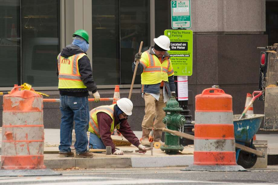 (FILES) In this file photo taken on December 8, 2017, men work on a construction site in Washington, DC. - Hiring surged in the US in August, and employers increased wages by the most in nearly a decade as the jobs markets showed no sign of slowing, the government reported on September 7, 2018. The unexpected hiring spree, which saw jobs sprout up in construction, transportation, wholesale trade, finance and health care, was a shot in the arm for President Donald Trump. The US economy added 201,000 new jobs, well above analyst expectations, while the unemployment rate held steady at an already-low 3.9 percent and wage gains gained ground on inflation. (Photo by mari matsuri / AFP)MARI MATSURI/AFP/Getty Images Photo: MARI MATSURI, AFP/Getty Images
