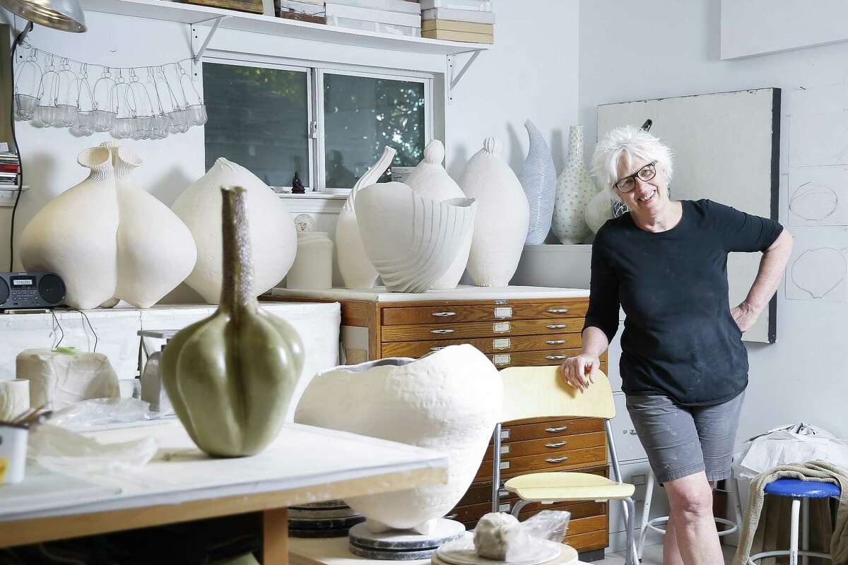 Sculptor Tracye Wear in her Heights studio