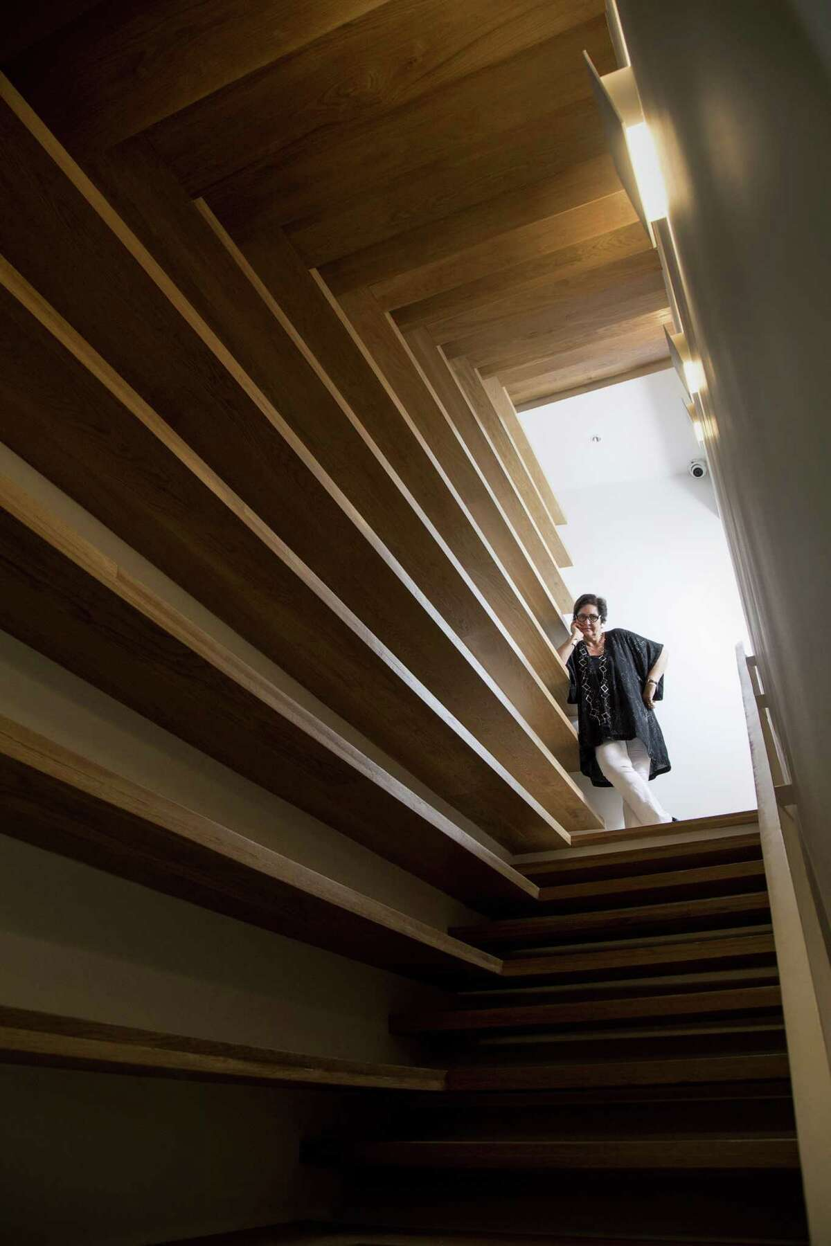The soul of the building lies within the custom shelves that form two stairwells, where Angelini plans to install her 8,000-book research library.