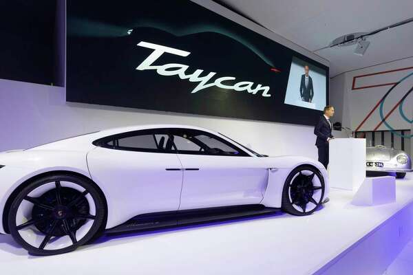 1of15in This Aug 6 2018 Photo Provided By Porsche Ag Oliver Blume Ceo Of Speaks Next To The Taycan During Ceremonial Opening 70