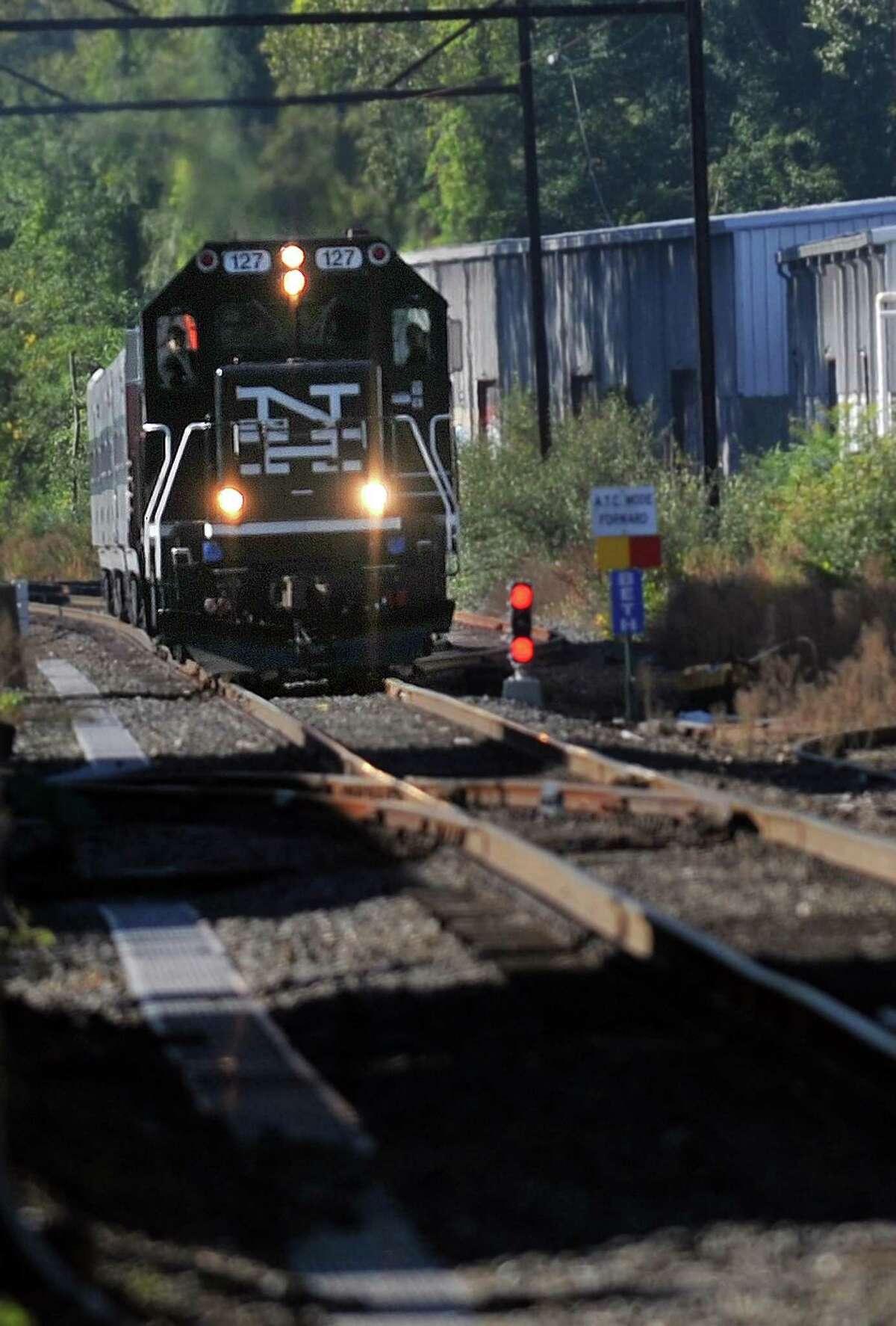 A Metro North train nears the Bethel, Conn. train station, Sept. 20, 2013.