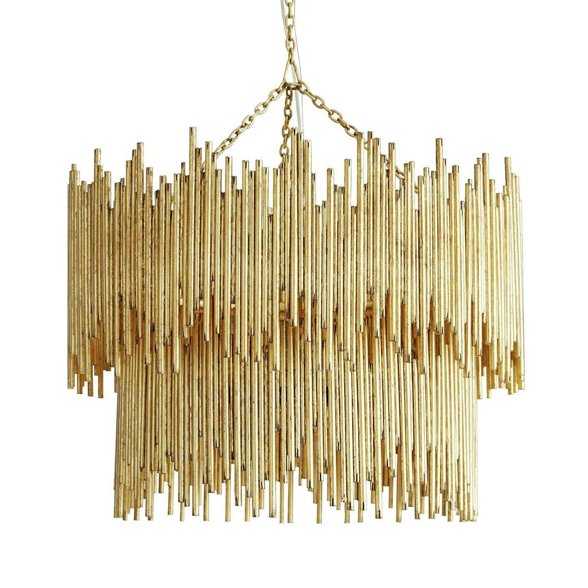 Crowning achievement:Gold leaf adds shimmer to the iron rods welded together to form this two-tier Prescott chandelier by Arteriors. The eight-light fixture comes in single-tier, sconce or oval-mirror versions in gold leaf or silver leaf. $4,200; Arteriors vendors and arteriorshome.com
