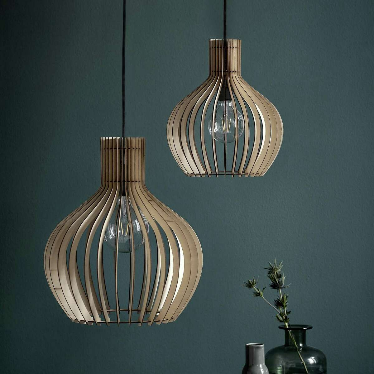 Gather a group: A by Amara's Groa wood pendant light casts beautiful shadows when light beams through its slatted wooden shade. The 14-inch-long fixture holds a single 60-watt bulb, so a cluster may be in order. $118; amara.com
