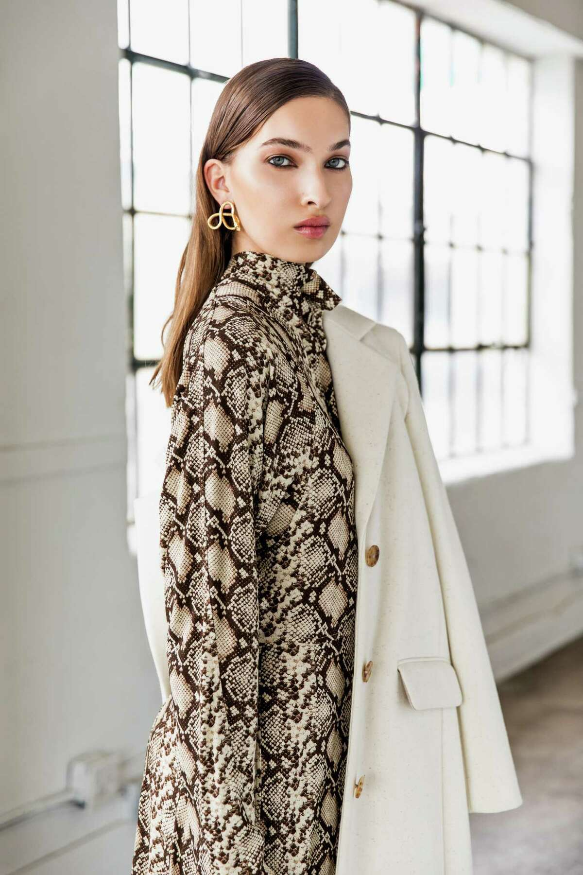 Celine snake print dress, $2,300, and The Row cream coat, $1,990, both at The Webster. Jennifer Behr earrings, $395, at Tootsies.