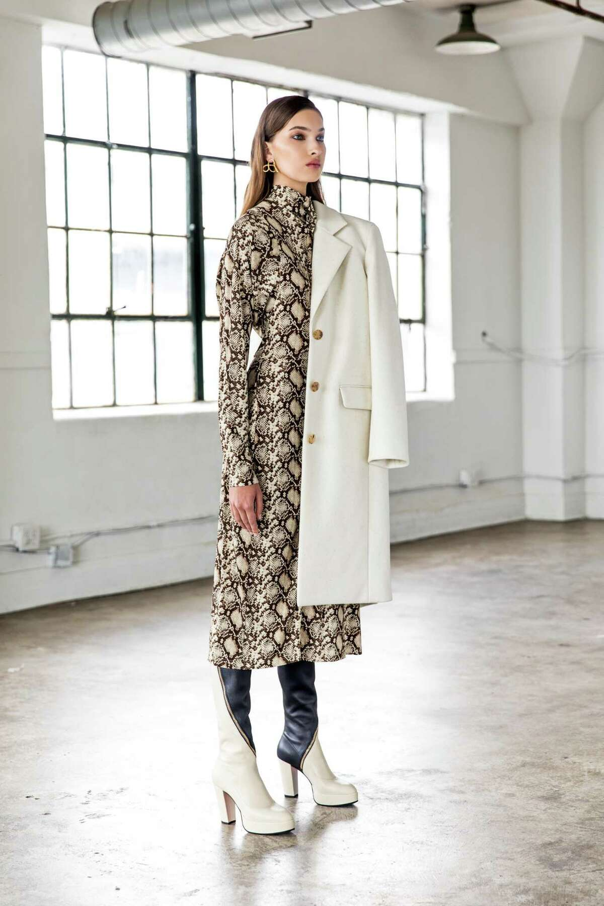 Celine snake print dress, $2,300, The Row cream coat, $1,990, and Gucci boots, $1,980, all at The Webster. Jennifer Behr earrings, $395, at Tootsies.