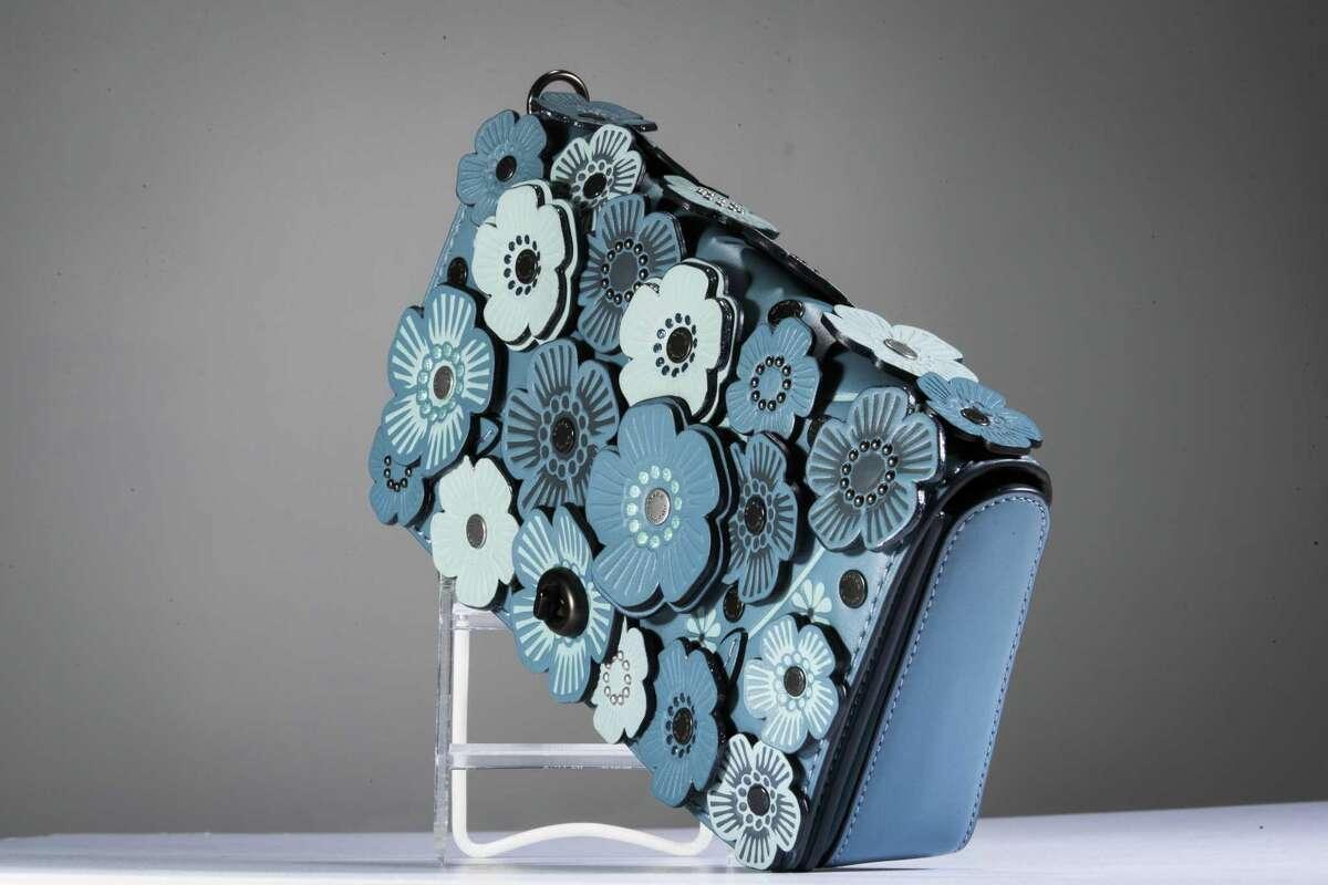 Coach blue flower bag, $595, Neiman Marcus