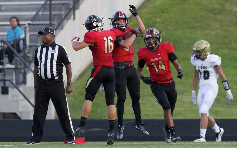 Caney Creek senior Cody Fay, second from left, reacts beside after hauling in a 22-yard touchdown pass from quarterback Julian Hernandez against Lake Creek back in August. Photo: Jason Fochtman, Staff Photographer / Houston Chronicle / © 2018 Houston Chronicle