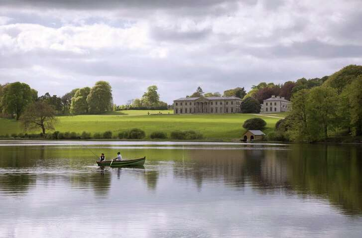 At Ballyfin, stone walls enclose 614 acres of parkland, lake and ancient woods.