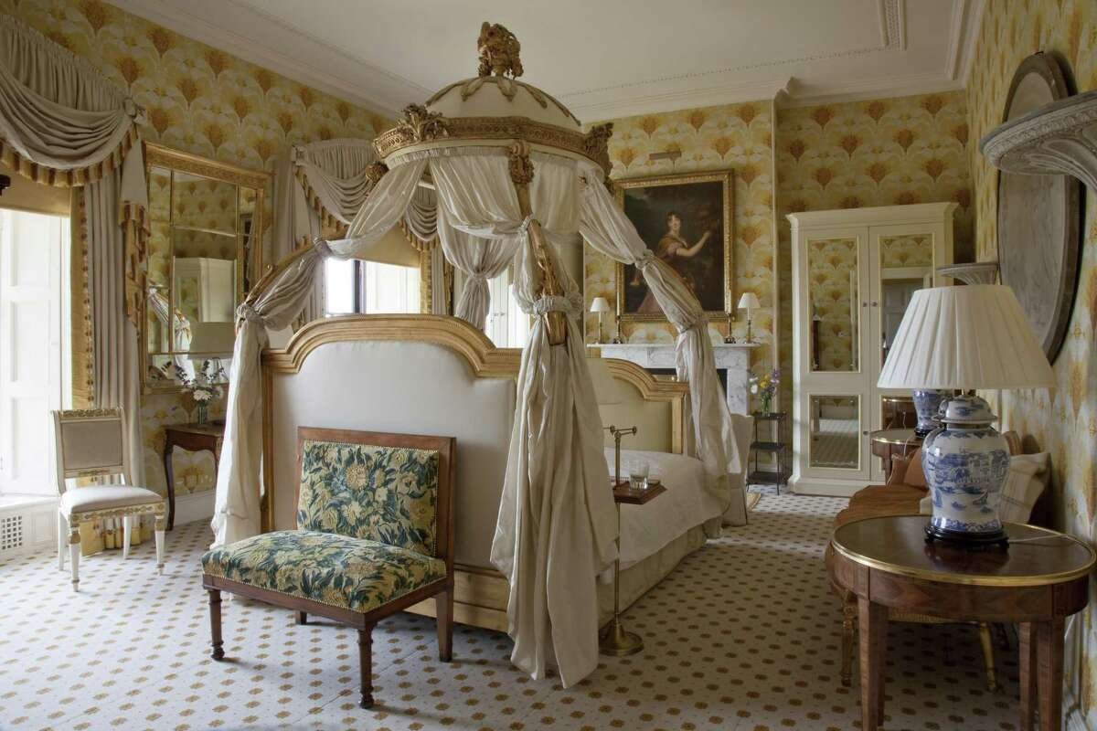 The Westhmeath room at Ballyfin features a carved French bed.