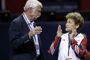 FILE - In this June 29, 2012, file photo, Bela Karolyi, left, and his wife Martha Karolyi talk on the arena floor before the start of the preliminary round of the women's Olympic gymnastics trials in San Jose, Calif. A former member of the U.S. national team is the latest gymnast to file suit over sexual abuse by imprisoned former sports doctor Larry Nassar. Sabrina Vega was on the team that won a gold medal at the 2011 World Championships. The 22-year-old filed a lawsuit in Texas Tuesday, May 1, 2018, against Nassar, USA Gymnastics, the U.S. Olympic Committee and Bela and Martha Karolyi, who ran a ranch near Houston that was the training ground for U.S. women's gymnastics. In a statement, Vega alleges the organizations and the Karolyis didn't protect her and other athletes from Nassar's abuse.(AP Photo/Gregory Bull, File)