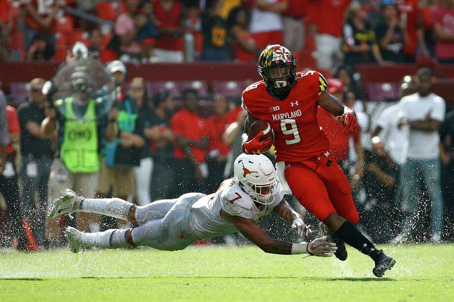 Maryland wide receiver Jahrvis Davenport, right, rushes past Texas defensive back Caden Sterns in the second half of an NCAA college football game, Saturday, Sept. 1, 2018, in Landover, Md. (AP Photo/Patrick Semansky) Photo: Patrick Semansky, Associated Press / Copyright 2018 The Associated Press. All rights reserved.