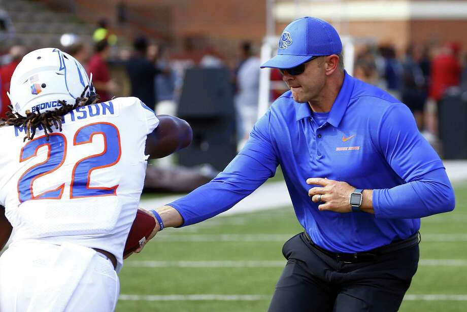Boise State head coach Bryan Harsin, right, hands of the ball to running back Alexander Mattison as they warm up before a game against Troy on Sept. 1. (AP Photo/Butch Dill) Photo: Butch Dill / Associated Press / Associated Press