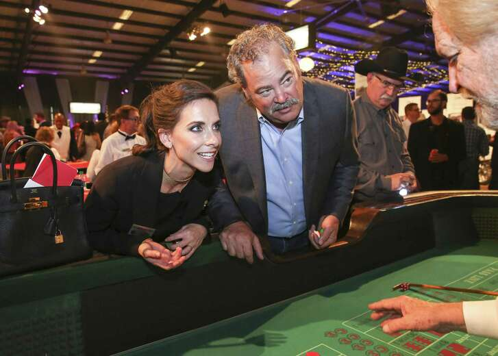 Hannah and Cal McNair spend some time playing craps during Cattle Baron's Ball at George Ranch Historical Park Saturday, April 29, 2017, in Richmond. ( Yi-Chin Lee / Houston Chronicle )