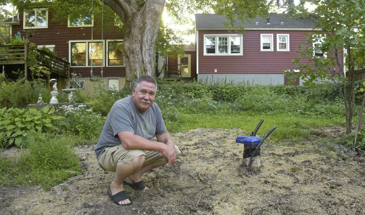 Arthur DePoi next to the new well that was drilled on his property. The new well is over 300 feet deep, the old well was 35 feet deep. Some residents near Huckleberry Hill Elementary School are having a problem with salt in their wells. Thursday, August 30, 2018, in Brookfield, Conn.