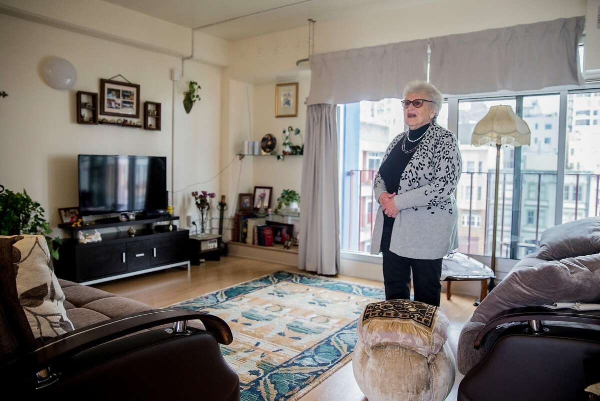 Chinatown Community Development Center's Community Tenants Association Vice President Susanna Sandler stands in the living room of her one bedroom unit at 990 Pacific Avenue, an affordable housing community in the Chinatown neighborhood of San Francisco, Calif. Thursday, Sept. 6, 2018.