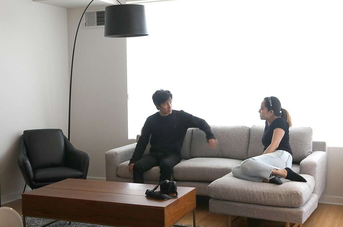 Takeshi and Yuka Ohishi try out a new couch.