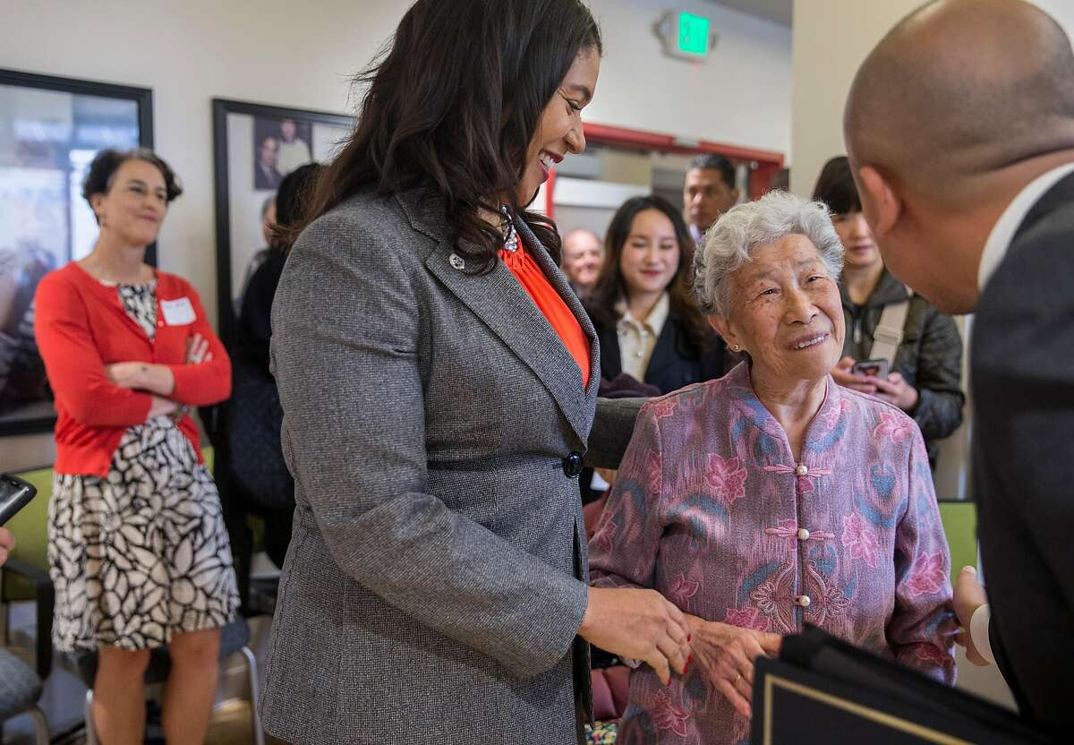 Mayor London Breed greets 990 Pacific Avenue resident Xiao Ying Zhao Lin following a grand opening ceremony for 990 Pacific Avenue, an affordable housing community in the Chinatown neighborhood of San Francisco, Calif. Thursday, Sept. 6, 2018.