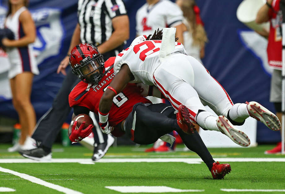 Texas Tech Red Raiders wide receiver De'Quan Bowman (8) is tackled by Mississippi Rebels linebacker Kevontae' Ruggs (27) during a kick return during the first quarter of an NCAA game at NRG Stadium Saturday, Sept. 1, 2018, in Houston. Photo by Godofredo A. Vasquez | Houston Chronicle Photo: Godofredo A. Vasquez | Houston Chronicle