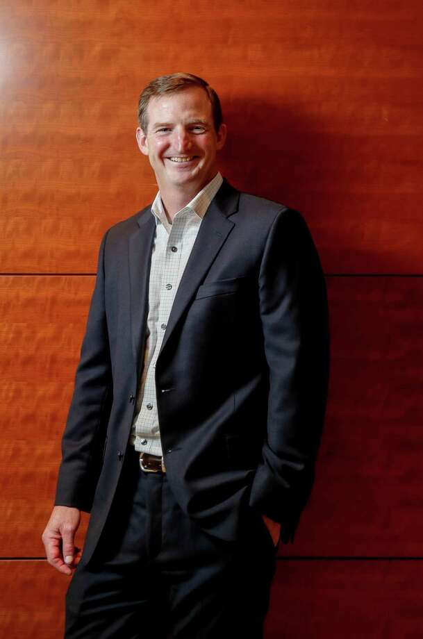 PHOTOS: EY in Houston Bill Strait, a partner with Ernst & Young, poses for a portrait Wednesday, Aug. 1, 2018, in Houston. >>The firm as flourished with the city... Photo: Jon Shapley, Staff Photographer / Staff Photographer / © 2018 Houston Chronicle