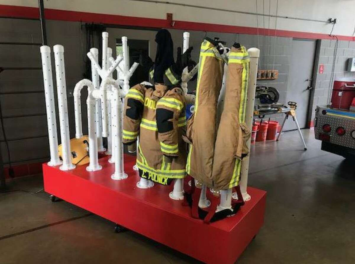 A firefighter with The Woodlands Fire Department theorized, designed and then constructed this unique uniform dryer in 2018. The dryer allows for the firefighting specialty uniforms - called 'buknker gear' - to be dried much faster than in a normal spin-dryer. The issue of cleaning the suits has become more critical in the era of COVID-19 novel coronavirus pandemic.