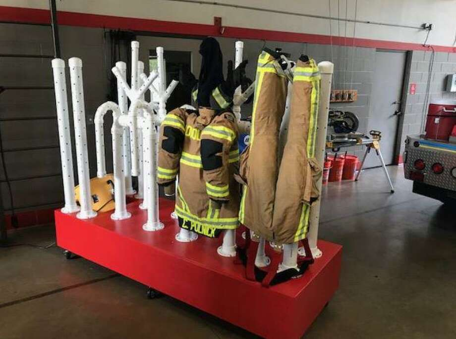 PHOTOS: Houston's unique inventionsChris Polnick, a firefighter with The Woodlands Fire Department theorized, designed and then constructed this unique uniform dryer. The dryer allows for the fire fighting specialty uniforms, also known as PPE or Personal Protection Equipment, to be dried much faster than in a normal spin-dryer.>>>See inventions and innovations that came from the Houston area... Photo: Courtesy Photograph/The Woodlands Fire Department / Courtesy Photograph/The Woodlands Fire Department