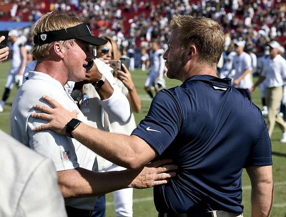 """FILE - In this Aug. 18, 2018, file photo, Los Angeles Rams head coach Sean McVay, right, greets Oakland Raiders head coach Jon Gruden after their NFL preseason football game, in Los Angeles. There is quite a bit of intrigue in what Gruden's offense will look like in his first game as coach in 10 years. He spent the past nine seasons after being fired in Tampa Bay as the analyst for """"Monday Night Football."""" Gruden spent much of the offseason talking about wanting to bring the Raiders back to 1998. He showed almost none of his offense in the preseason but his former protege and current Rams coach Sean McVay knows to expect the unexpected.(AP Photo/Kelvin Kuo, File) Photo: Kelvin Kuo / Associated Press"""