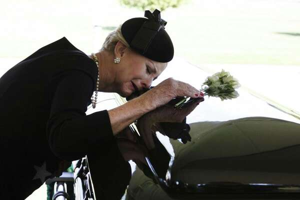 Cindy McCain grieves at the casket of her husband, Sen. John McCain, during the burial service at the U.S. Naval Academy on Sunday. The McCain family - understandably - did not want the president near his flag-draped casket.