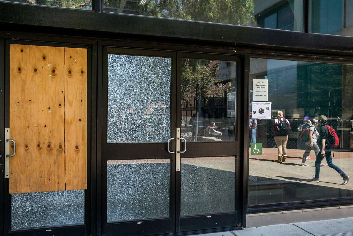 A broken glass door at the old Laney College gym. The college district is beset by critics charging mismanagement.