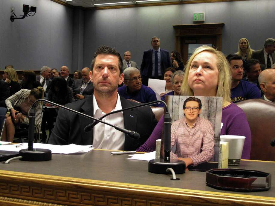 In this March 21, 2018 file photo, Stephen and Rae Ann Gruver sit in a House committee room behind a photo of their son, 18-year-old Maxwell Gruver, a Louisiana State University freshman who died with a blood-alcohol content six times higher than the legal limit for driving in what authorities say was a hazing incident, in Baton Rouge, La. Photo: Melinda Deslatte /Associated Press / Copyright 2018 The Associated Press. All rights reserved.