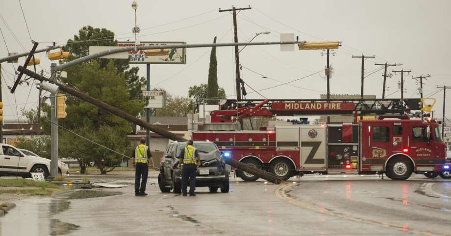 Midland fire and rescue block the intersection at Lamesa and Florida  09/07/18 after a vehicle knocked down a utility pole. Tim Fischer/Reporter-Telegram Photo: Tim Fischer/Midland Reporter-Telegram