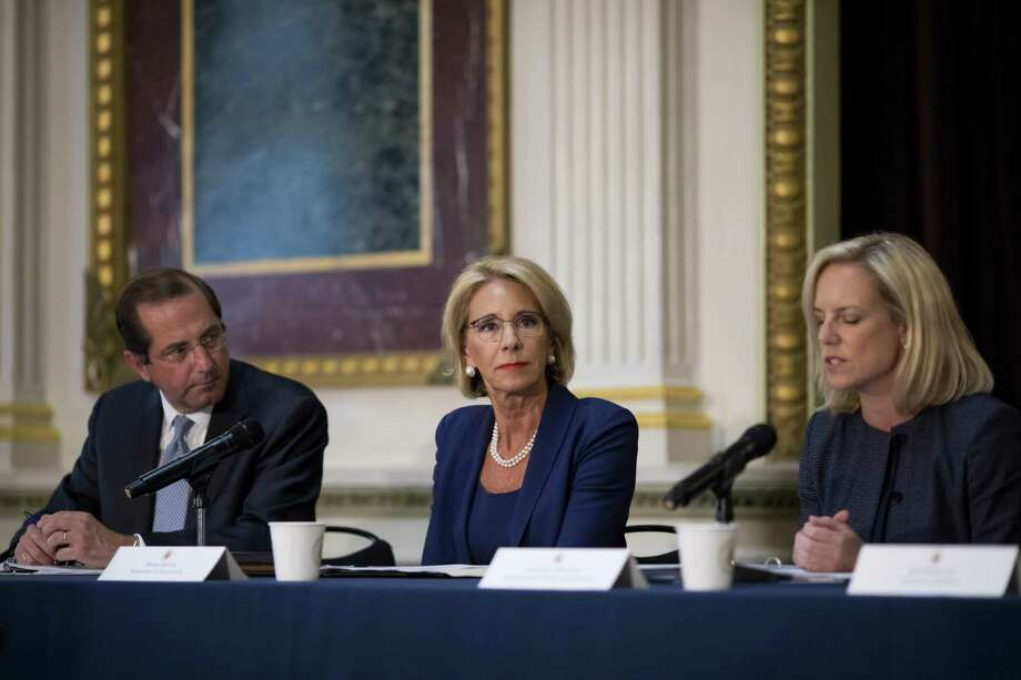 Education Secretary Betsy DeVos, center, attends a policy meeting in Washington, Aug. 16. DeVos is preparing new policies on campus sexual misconduct that would bolster the rights of students accused of assault, harassment or rape, lessen liability for schools, and encourage them to provide more support for victims. Photo: ERIC THAYER /NYT / NYTNS