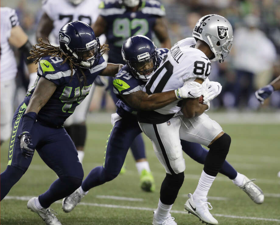 Seahawks' starting right cornerback Dontae Johnson is reportedly headed to Injured Reserve. He was listed as questionable on the injury report with a groin issue. The move means he's not game eligible until Week 9. Photo: Stephen Brashear/Associated Press