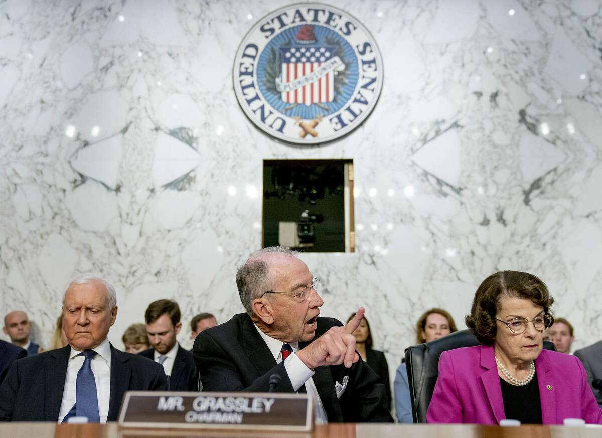 Senate Judiciary Chairman Chuck Grassley, R-Iowa, center, accompanied by Sen. Orrin Hatch, R-Utah, left, and Sen. Dianne Feinstein, D-Calif., the ranking member on the Senate Judiciary Committee, right, speaks toward the committee Democrats as President Donald Trump's Supreme Court nominee, Brett Kavanaugh, a federal appeals court judge, appears before the Senate Judiciary Committee on Capitol Hill in Washington, Tuesday, Sept. 4, 2018, to begin his confirmation to replace retired Justice Anthony Kennedy. (AP Photo/Andrew Harnik)