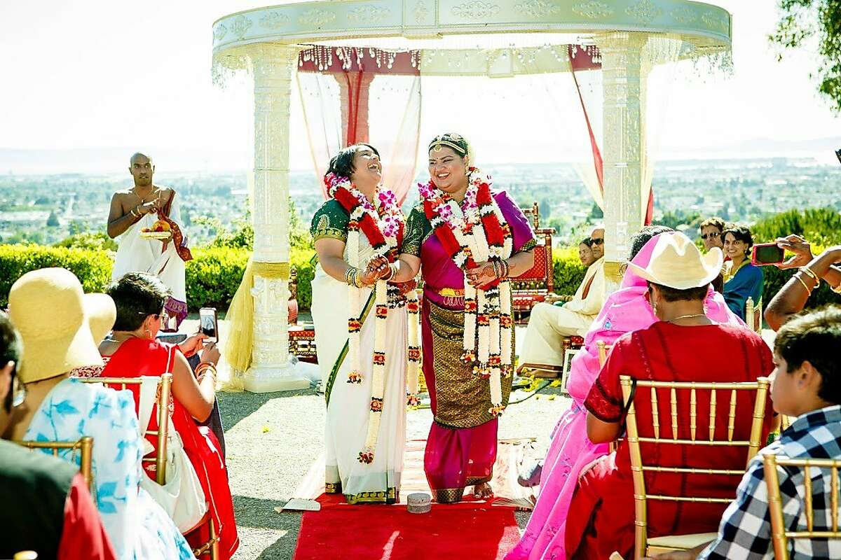 Priti Narayanan (right) and her wife, Madhuri �Mads� Anji (left) at their wedding in 2014.
