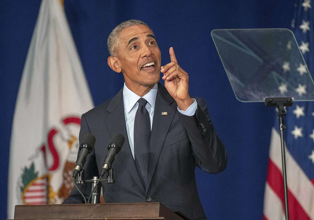 Former President Barack Obama speaks in Foellinger Auditorium on the University of Illinois campus in Urbana, Ill., on Friday, Sept. 7, 2018. Obama will receive a medal for the Paul H. Douglas Award for Ethics in Government at a private ceremony following the speech. (Stephen Haas//The News-Gazette via AP)