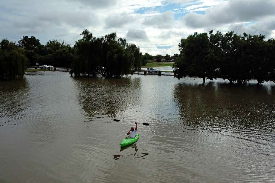 A kayaker enjoys a flooded Grafa Park, Sept. 7, 2018. James Durbin/Reporter-Telegram Photo: James Durbin